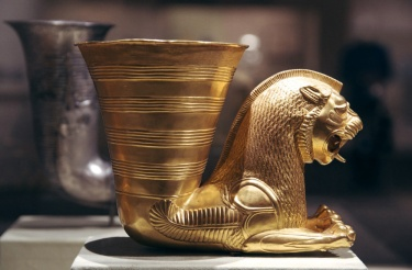 Rhyton in the shape of a seated lion-monster, from Hamadan, Iran by Achaemenid